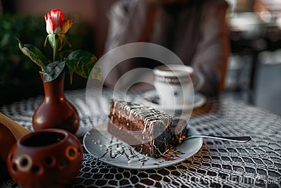 Delicious chocolate cake and a cup of coffee