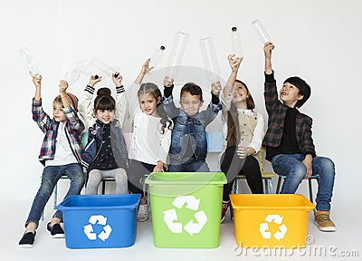Group of children with a recycling symbol.