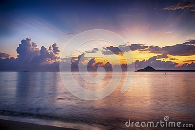 fantasy image of beach with sunlight effect, soft wave hitting the shore