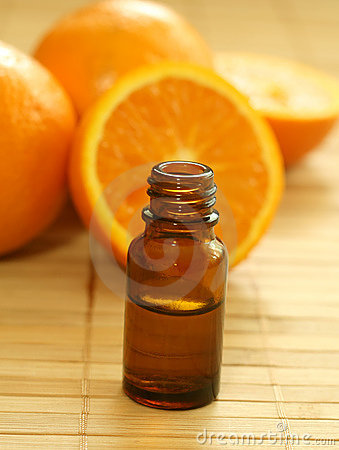 bottle of essence oil and fresh oranges