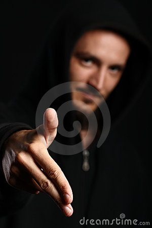 Young man points his two fingers forward down