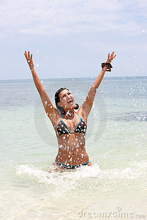 Beach woman splashing