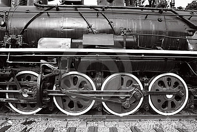 Close-up of wheels of old steam train