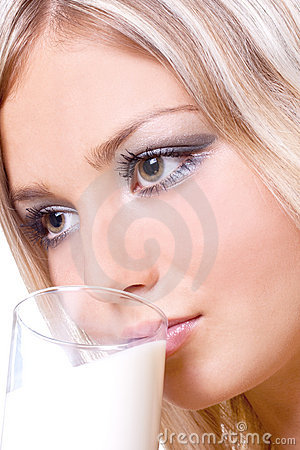 Beautiful woman drinking milk