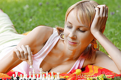 Blonde playing chess
