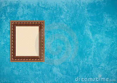Grunge blue stucco wall with empty picture frame