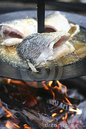 Fish cooking on open fire
