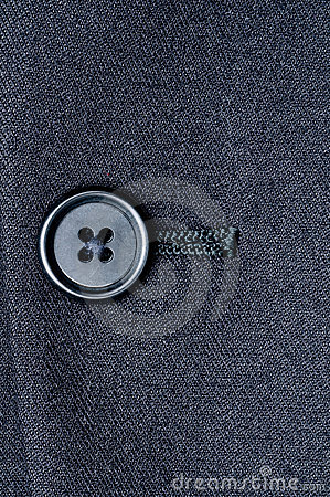 A closed button on a suit jacket