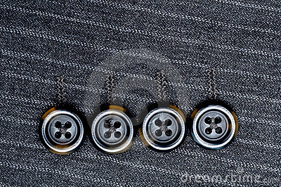 Four buttons on a pin-striped suit