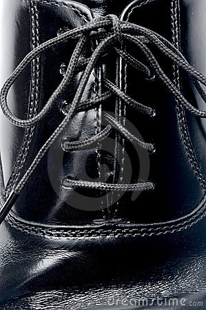 Laces on a black leather shoe