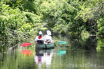 Couple kayaking in a river