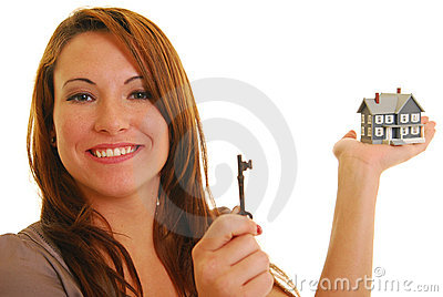Attractive woman with key and miniature house