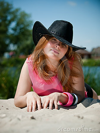 Young pretty girl in cowboy hat