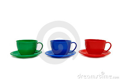 Three colour cups - toys on a white background