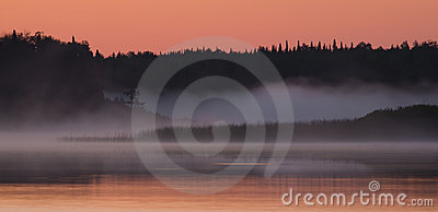 Salmon Sky and Foggy Water