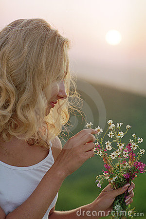 Beautiful woman with bunch of wildflowers
