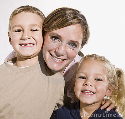 Mother and Children Smiling at Camera