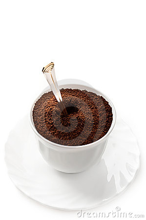 Cup full of ground coffee