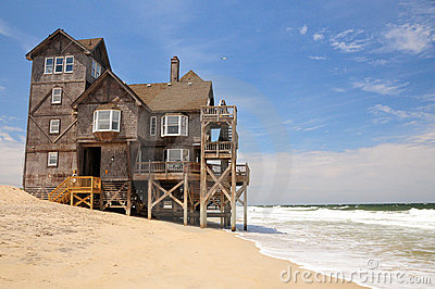 Beach house on eroded coast