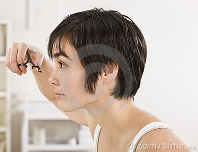 Woman Trimming Bangs