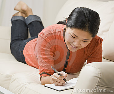 Woman Writing in Book