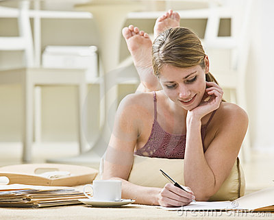 Woman Writing on Files