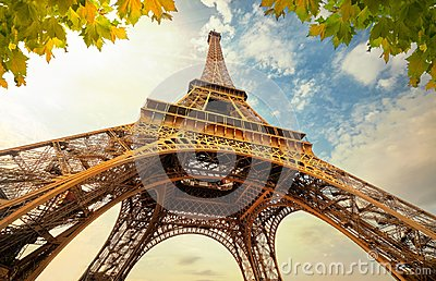 Eiffel Tower in Paris France with Golden Light Rays.