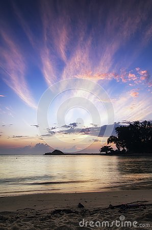 Beautiful sea view scenery over stunning sunrise background. sunlight beam and soft wave hitting sandy beach