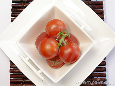 Small tomatoes in a chinaware