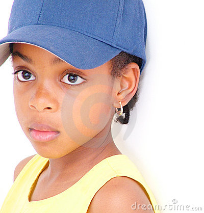 Young girl in baseball cap