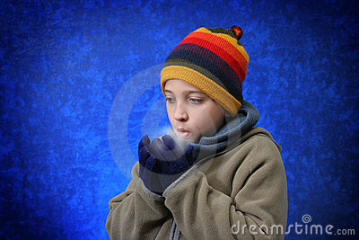 Boy trying to warm his hands