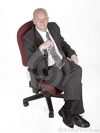 Man In Chair Holding Glasses