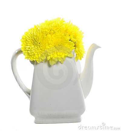 Yellow flowers in teapot