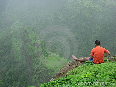 Man relaxing on mountainside