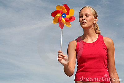 Woman Blowing Pinwheel