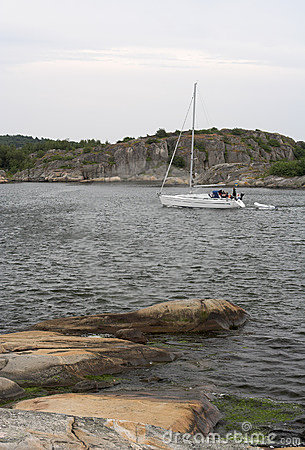 Yacht moving between the rocks