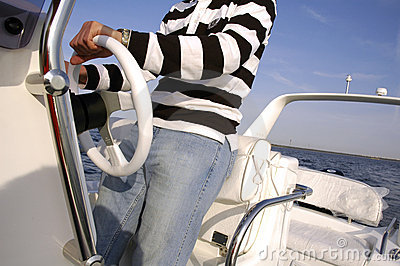 Man steering a speedboat