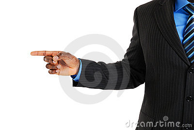 Business man pointing into copyspace