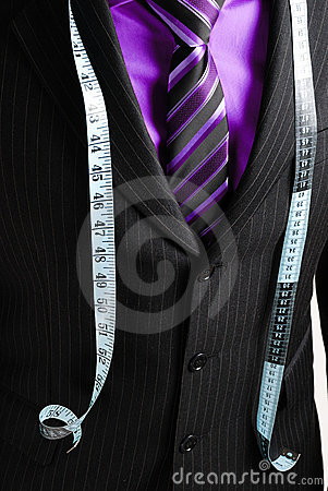 Business man with tape measure