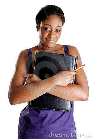 Young female student holding pencil and book