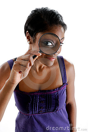 Student looking through a magnifying glass