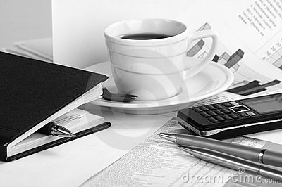 Cup  coffee on a morning papers