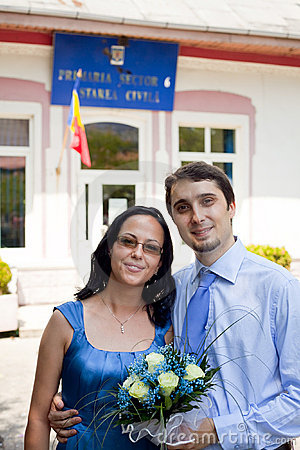 Just married - happy young couple outdoor