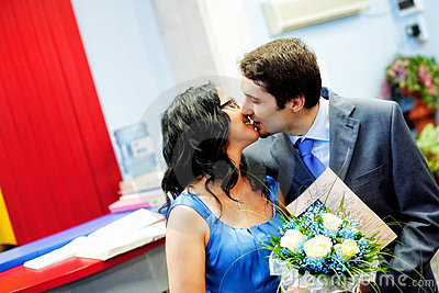 Happy married couple kissing with love