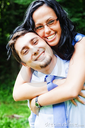 Smile of happy joyful couple embracing