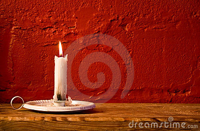 Burning candle red wall