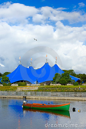 Traveling circus on the bank of the river