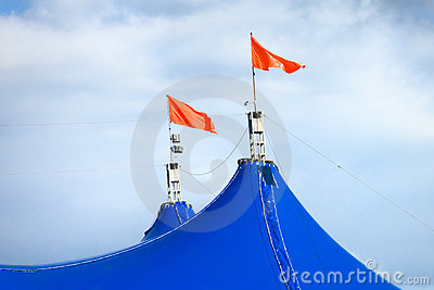 Red flags on top of circus tent