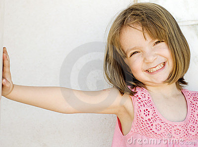 Happy little smiling girl leaning