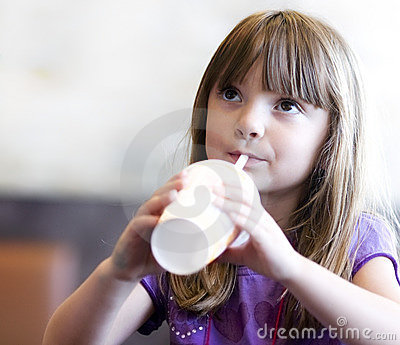 Little girl drinking soda pop